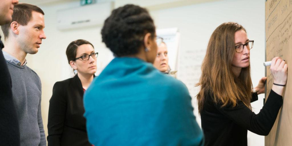 Course participants brainstorm at a flipchart
